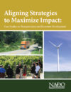 Report cover with truck driving on rural road, group of individuals at a groundbreaking ceremony, and a wind turbine in an open field.